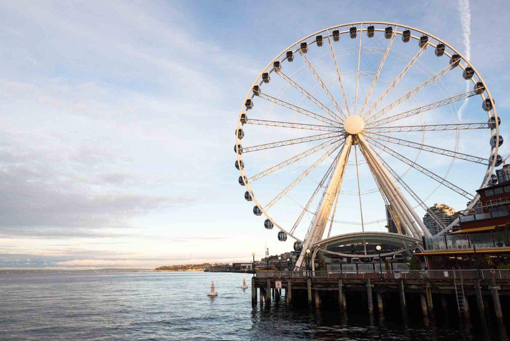 Sunset view of Ferris wheel in Seattle