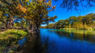 Bright Beautiful Fall Foliage on the Crystal Clear Frio River in Garner state park is one of the best hiking trails in San Antonio
