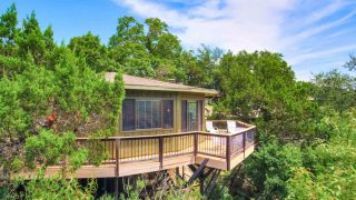 This Treehouse on the lake is one of the romantic cabins in Texas