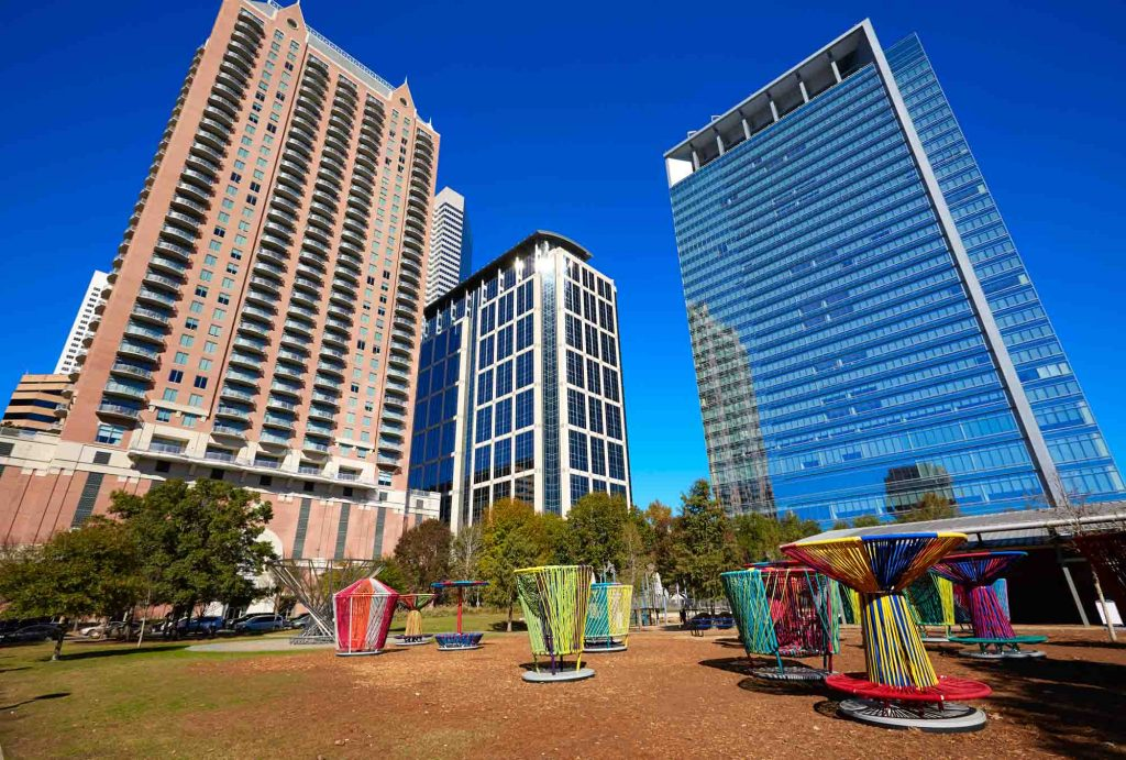 Admiring the Skyline at Discovery Green is one of the best things to do in Houston
