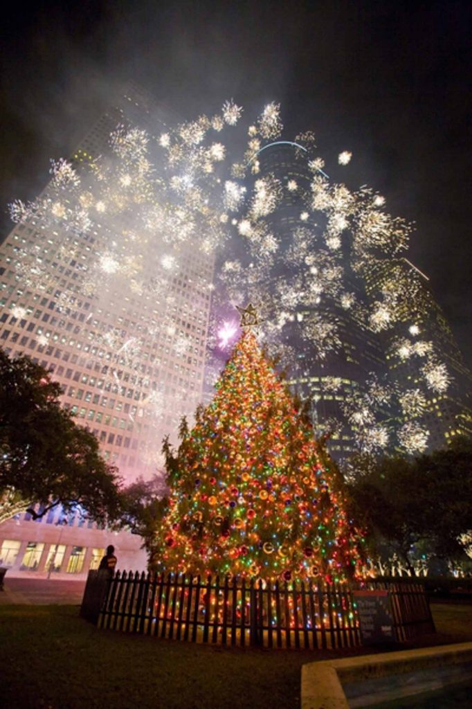 Taking Holiday Photos at the Christmas tree at the City Hall is one of the festive ways to spend Christmas in Houston