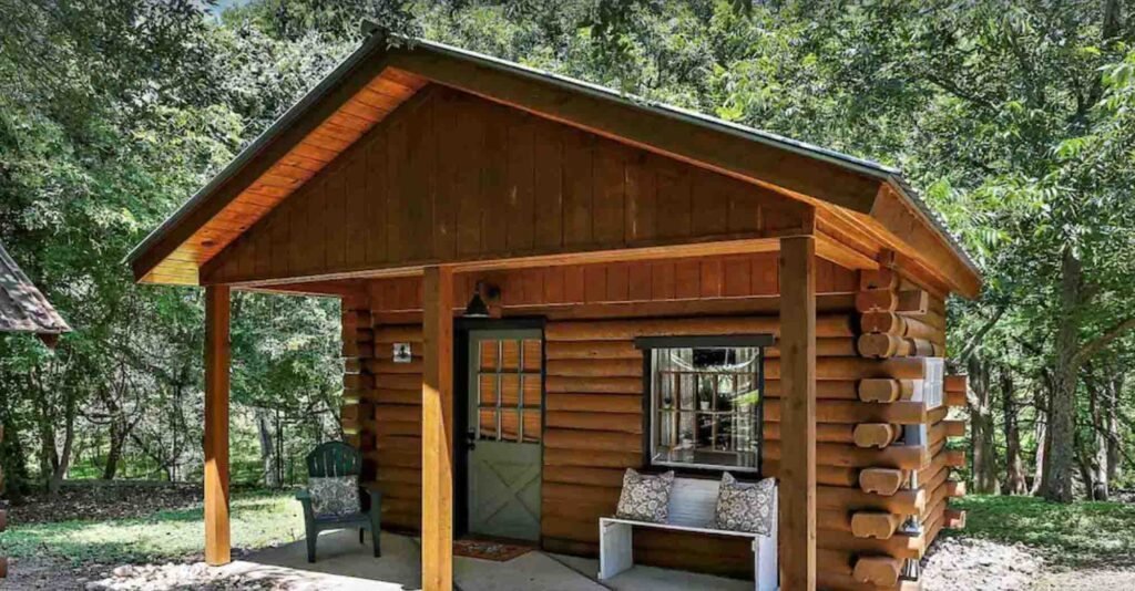 This cozy log cabin retreat for two is one of the cabins in Wimberley, Texas