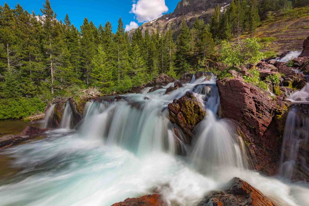 Redrock Falls is one of the best hikes in Glacier National Park