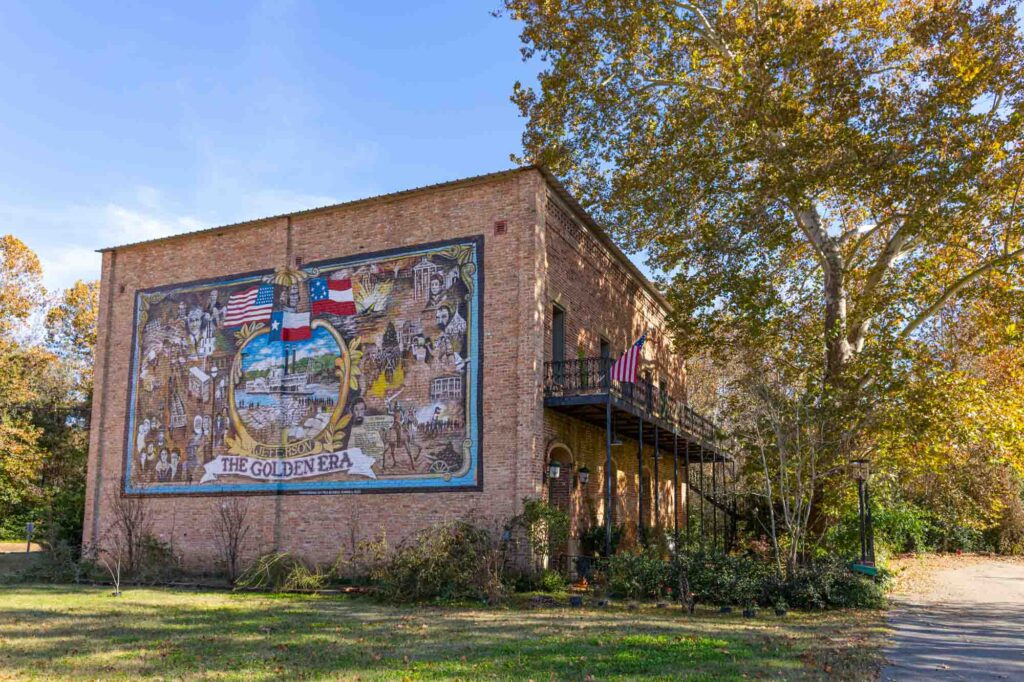Taking some cool photos at the Golden Era Mural is one of the fun things to go in Jefferson,TX